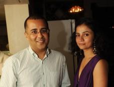 Writer Chetan Bhagat with a friend Photos