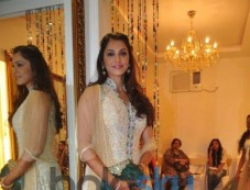 Isha Koppikar unveils Sujata Ahuja and Sanjay Lalwani's Bridal Collection Photos