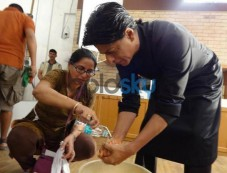 Shahrukh Khan washing hand doing shoot Photos