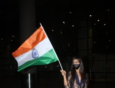 Miss Universe Andrea Meza Arrives Holding Our National Flag In Pride & Respect At Airport Photos