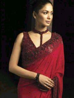 Ethnic red saree emroidered with black stones