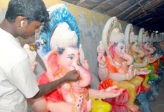 Artist Giving Finishing Touch to Ganesh Idol