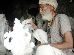 A craftsman making Ganesh idol