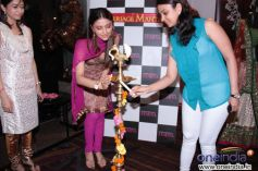 Aarti Chhabria and Poonam Ramchandani lighting a diya