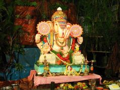 Ganesha standing in front of a waterfall