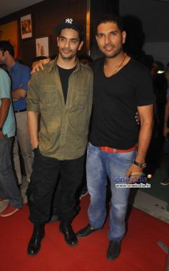 Cricketer Yuvraj Singh along with his friend Angad at Relaunch of Golds Gym Bandra