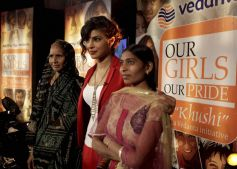 Priyanka Chopra poses with two members of the audience