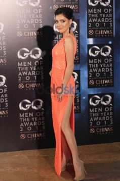 Model in orange dress GQ Man of the Year Award 2013