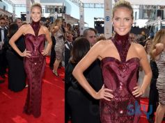 Heidi Klum, in Versace, arrives at the 65th Primetime Emmy Awards