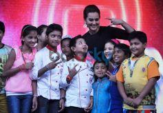 Actress Sonakshi Sinha with junior masterchefs on Junior MasterChef tv show sets.