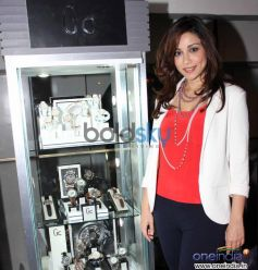 Amrita Puri poses with bestselling watch collection of guess amp