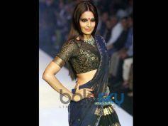 Bipasha Basu in Red Bindi and black and golden mix dress