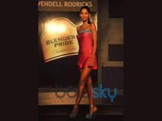 Blender Pride Fashion Tour model in beautiful red dress