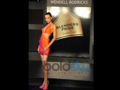 Blender Pride Fashion Tour model in orange outfit and high heels
