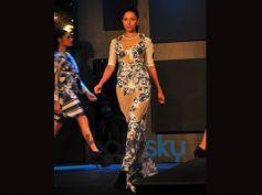 Blender Pride Fashion Tour model walking on ramp in pattern dress