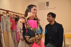 Isha Koppikar checking out  Sujata Ahuja and Sanjay Lalwani's Bridal Collection