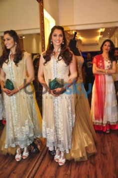 Isha Koppikar posing to camera at  Sujata Ahuja and Sanjay Lalwani's Bridal Collection