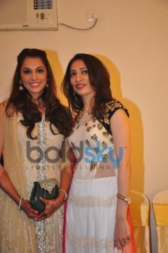 Isha Koppikar Posing with Sujata Ahuja and Sanjay Lalwani's Bridal Collection