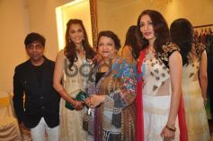 Isha Koppikar snapped at the unveiling of Sujata Ahuja and Sanjay Lalwani's Bridal Collection