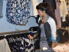 Jacqueline Fernandez checking out clothes