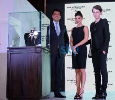 Jacqueline Fernandez pose to camera Foremark jewellery with Gareth Pugh