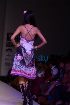 Model back pose in beautiful outfit at show