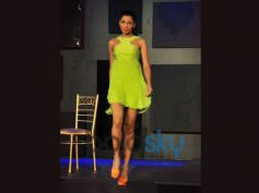 Model ramp walk in green costume Blender Pride Fashion Tour