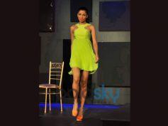 Model ramp walk in green costume Blender Pride Fashion Tour