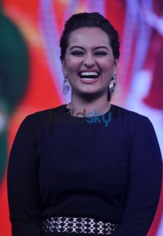 Sonakshi Sinha smilling and giving pose on Junior MasterChef tv show sets.