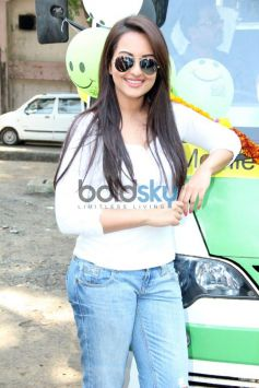 Sonakshi Sinha standing beside vehicle launch Smile on Wheels Events