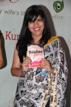 Aditi Mathur Kumar displaying her Book