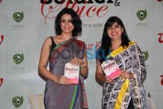 Gul Panag and  Aditi Mathur Kumar displaying Book