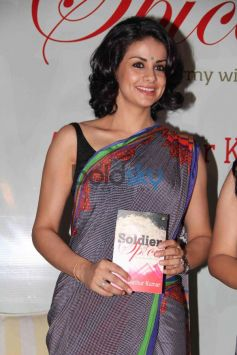 Gul Panag displaying Aditi Mathur Kumar Book