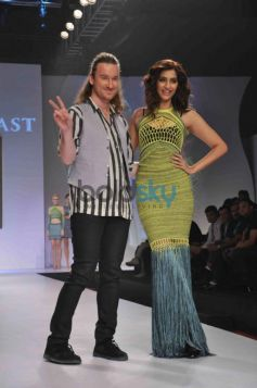 Sonam Kapoor with fashion designer Mark Fast on stage