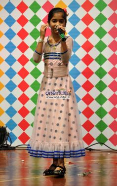 Girl singing during Save Electricity kids competition