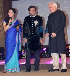 A.R. Rahman with guest on stage during event