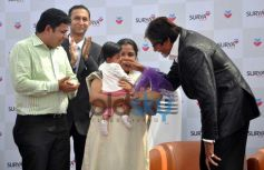 Amitabh Bachchan with babies on stage during Inauguration