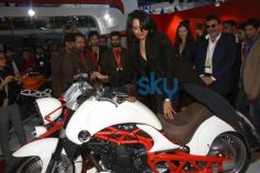 Sameera Reddy sitting on superbikeVardenchi at Auto Expo 2014