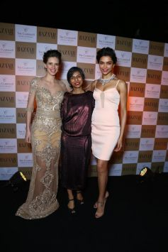 Deepika Padukone with Kalki Koechlin during unveils Harper's Bazaar India March 2014 cover