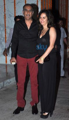 Milan Luthria with wife at Kangna Ranaut Birthday Bash