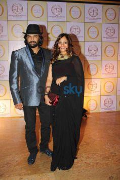 R Madhwan with wife atSatyug Gold party