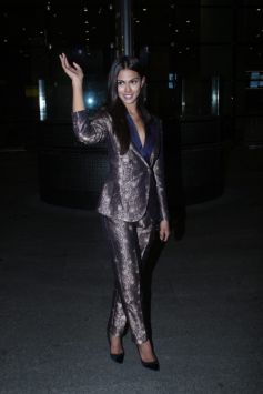 Miss Universe Andrea Meza Arrives Holding Our National Flag In Pride & Respect At Airport