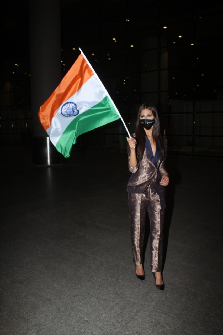 Miss Universe Adline Castelino Arrives Holding Our National Flag In Pride & Respect At Airport